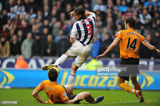 Jonas Olsson of West Bromwich Albion back heels the ball before Peter Odemwingie of West Bromwich Albion scored to make it 13