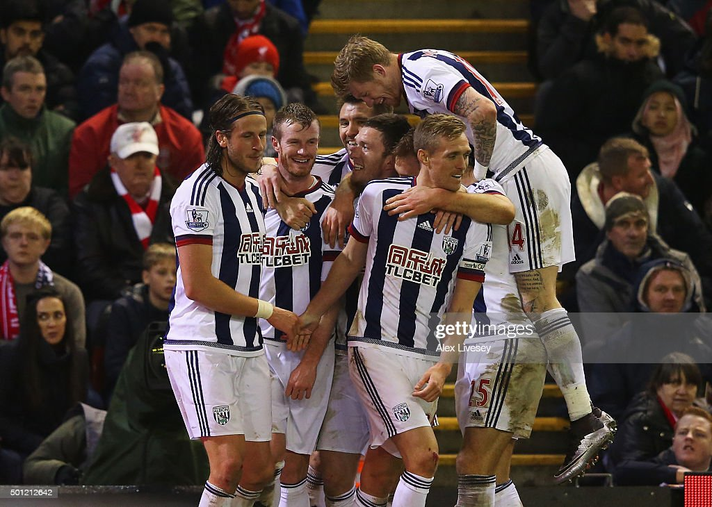 Jonas Olsson of West Bromwich Albion (L) celebrates with team mates as he scores their second goal during the Barclays Premier League match between Liverpool and West Bromwich Albion at Anfield on December 13, 2015 in Liverpool, England.