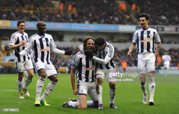 Jonas Olsson of West Bromwich Albion is congratulated on his goal during the Barclays Premier League match between Wolverhapton Wanderers and West...