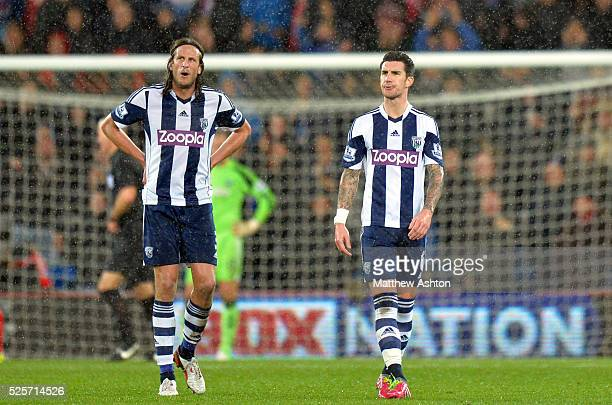 Jonas Olsson of West Bromwich Albion Liam Ridgewell of West Bromwich Albion watch the repalay on the big screen of the goal scored by Peter...