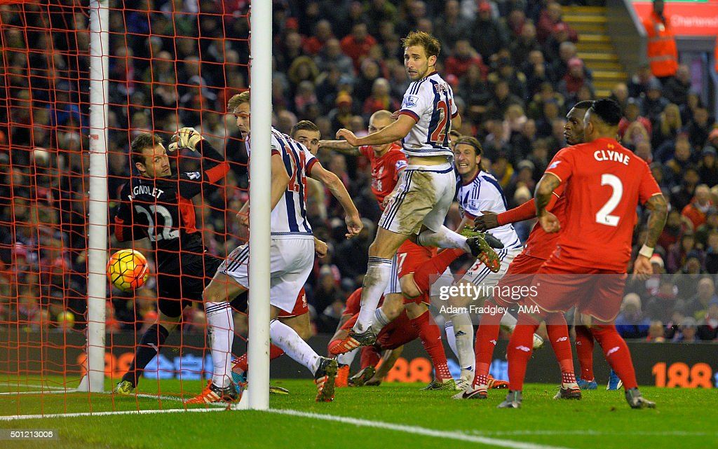 Jonas Olsson of West Bromwich Albion scores a goal to make it 1-2 during the Barclays Premier League match between Liverpool and West Bromwich Albion at Anfield on December 13, 2015 in Liverpool, England.
