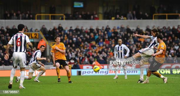 Jonas Olsson of West Bromwich Albion scores the second goal during the Barclays Premier League match between Wolverhapton Wanderers and West Bromwich...