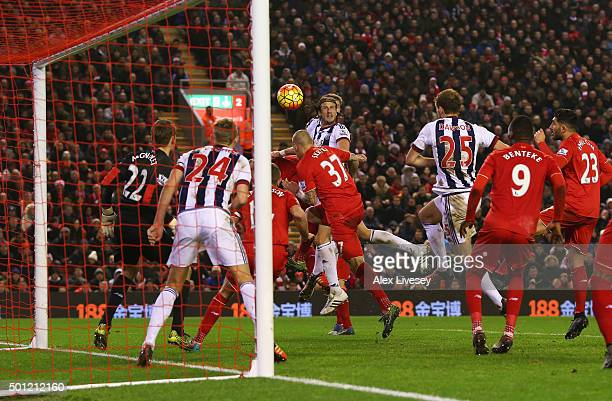 Jonas Olsson of West Bromwich Albion scores their second goal during the Barclays Premier League match between Liverpool and West Bromwich Albion at...