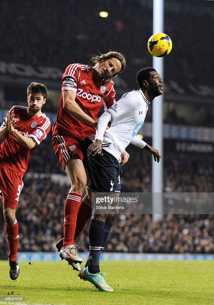 Jonas Olsson of West Bromwich and Emmanuel Adebayor compete for a header during the Barclays Premier League match between Tottenham Hotspur and West Bromwich Albion on December 26 2013 in London, England.