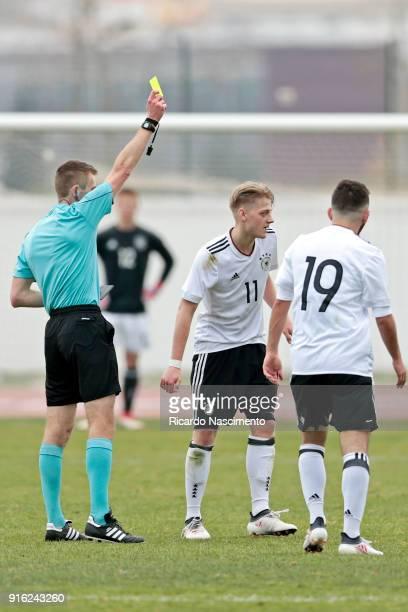 Jonas Pfalz of Germany U17 is shown a yellow card applied by Michael Salisbury during U17Juniors Algarve Cup match between U17 Netherlands and U17...