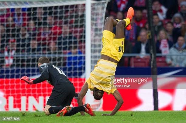 Jonas Ramalho of Gerona flips over after being fouled by Jan Oblak of Atletico de Madrid during the La Liga match between Atletico Madrid and Girona...