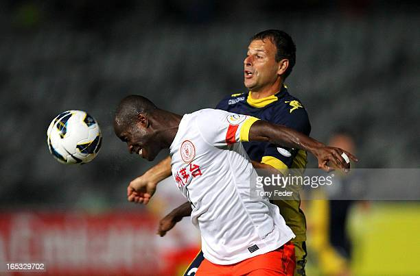 Jonas Salley of Guizhou and Mile Sterjovski of the Mariners contest the header during the AFC Asian Champions League match between the Central Coast...