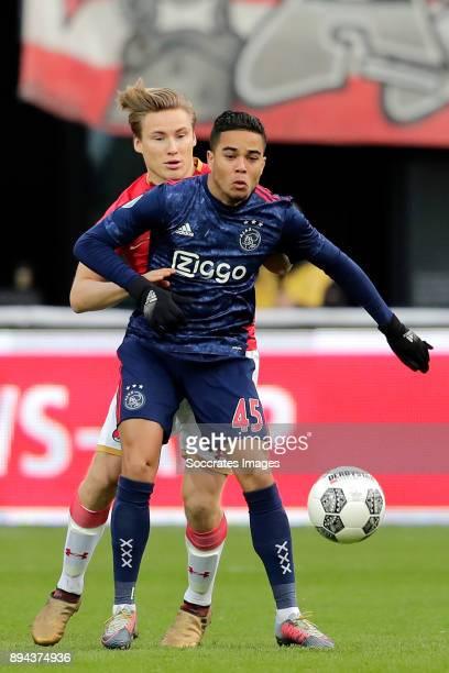 Jonas Svensson of AZ Alkmaar Justin Kluivert of Ajax during the Dutch Eredivisie match between AZ Alkmaar v Ajax at the AFAS Stadium on December 17...