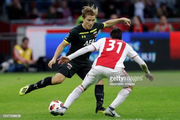 Jonas Svensson of AZ Alkmaar Nicolas Tagliafico of Ajax during the Dutch Eredivisie match between Ajax v AZ Alkmaar at the Johan Cruijff Arena on...