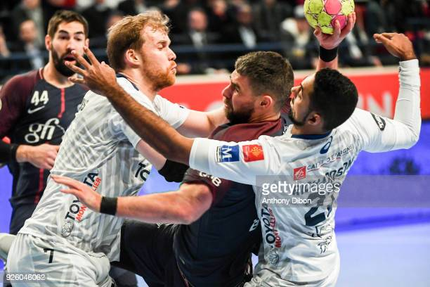 Jonas Truchanovicius of Montpellier and Luka Karabatic of PSG during the Lidl Starligue match between Paris Saint Germain and Montpellier at Stade...