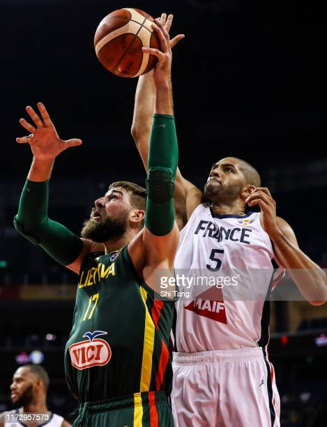 Jonas Valanciunas of Lithuania in action against Nicolas Batum of France during 2nd round Group L match between France and Lithuania of 2019 FIBA...