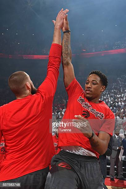 Jonas Valanciunas and DeMar DeRozan of the Toronto Raptors high five before Game Six of the NBA Eastern Conference Finals against the Cleveland...