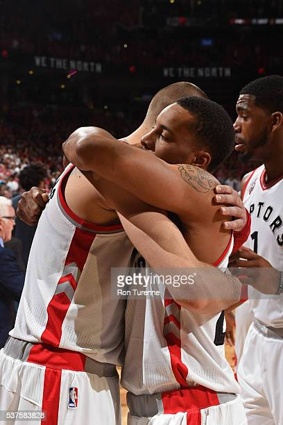 Jonas Valanciunas and Norman Powell of the Toronto Raptors hug after Game Six of the NBA Eastern Conference Finals against the Cleveland Cavaliers at...
