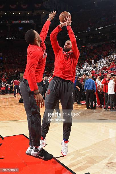 Jonas Valanciunas and Norman Powell of the Toronto Raptors warm up before Game Six of the NBA Eastern Conference Finals against the Cleveland...