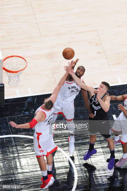 Jonas Valanciunas and Serge Ibaka of the Toronto Raptors rebound against Bogdan Bogdanovic of the Sacramento Kings on December 10 2017 at Golden 1...