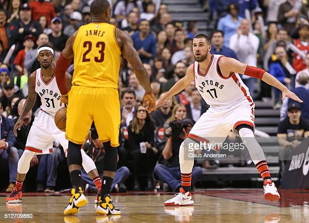 Jonas Valanciunas and Terrence Ross of the Toronto Raptors defend against LeBron James of the Cleveland Cavaliers during an NBA game at the Air...