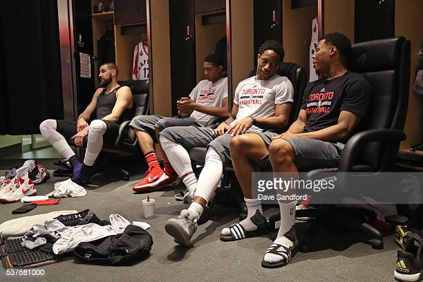 Jonas Valanciunas Bruno Caboclo DeMar DeRozan and Kyle Lowry of the Toronto Raptors sit by their lockers before Game Six of the NBA Eastern...