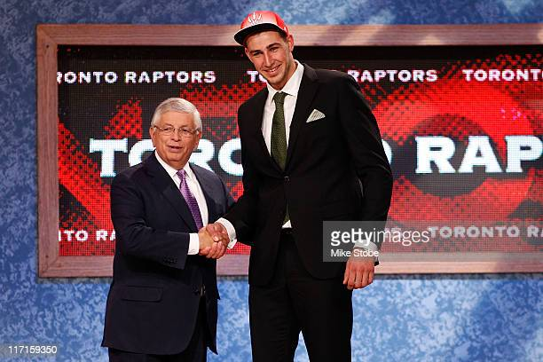 Jonas Valanciunas from Utena Lithuania greets NBA Commissioner David Stern after he was picked overall by the Toronto Raptors in the first round...