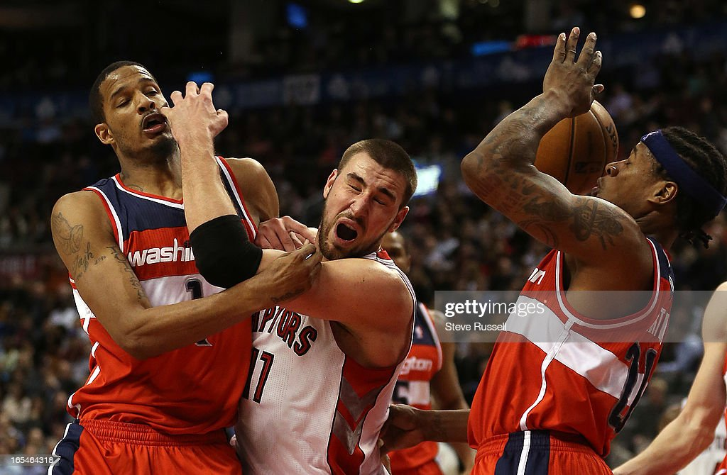 Jonas Valanciunas is fouled by Trevor Ariza in second half action as the Toronto Raptors beat the Washington Wizards 88-78 at the Air Canada Centre in Toronto.