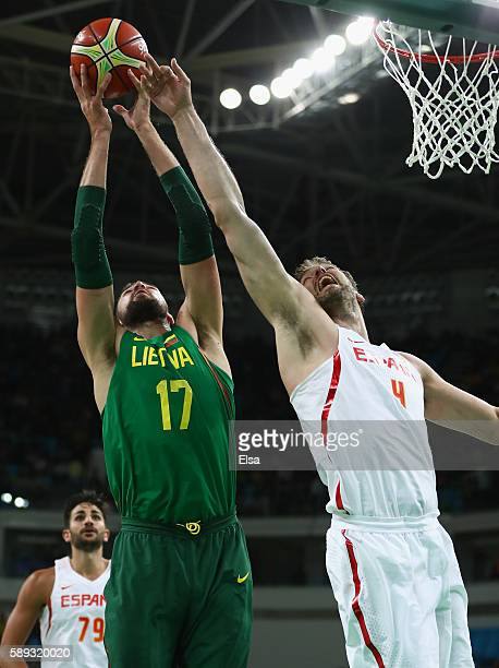 Jonas Valanciunas of Lithuania goes for the rebound against Pau Gasol of Spain during the Men's Preliminary Round Group B between Spain and Lithuania...