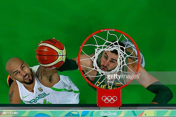 Jonas Valanciunas of Lithuania shoots over Marcus Vinicius Marquinhos of Brazil during a Men's preliminary round basketball game between Brazil and...