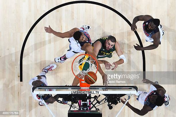 Jonas Valanciunas of the Lithuania Basketball Men's National Team fightrs for the ball against USA Basketball Men's National Team during a 2014 FIBA...