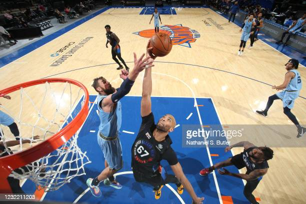 Jonas Valanciunas of the Memphis Grizzlies and Taj Gibson of the New York Knicks fight for the rebound during the game on April 9, 2021 at Madison...