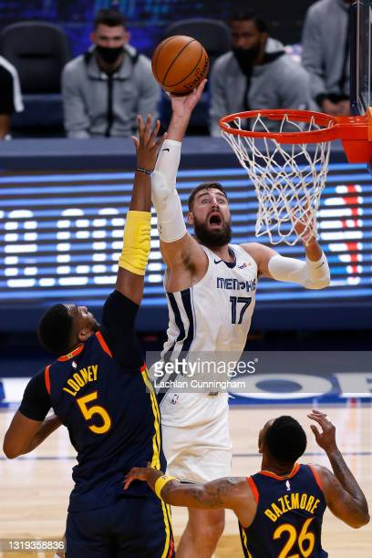 Jonas Valanciunas of the Memphis Grizzlies goes to the basket against Kevon Looney of the Golden State Warriors in the third quarter of the NBA...
