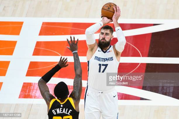 Jonas Valanciunas of the Memphis Grizzlies shoots over Royce O'Neale of the Utah Jazz in Game Five of the Western Conference first-round playoff...