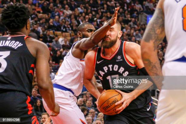 TORONTO ON FEBRUARY 8 Jonas Valanciunas of the Raptors gets an arm in the face from Tim Hardaway Jr of the Knicks during the 1st half of NBA action...