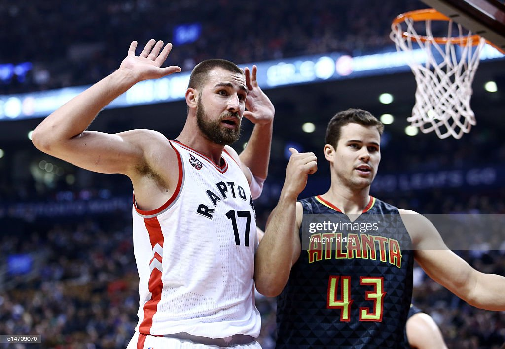 Jonas Valanciunas #17 of the Toronto Raptors appeals to the official as Kris Humphries #43 of the Atlanta Hawks looks on during the first half of an NBA game at the Air Canada Centre on March 10, 2016 in Toronto, Ontario, Canada.