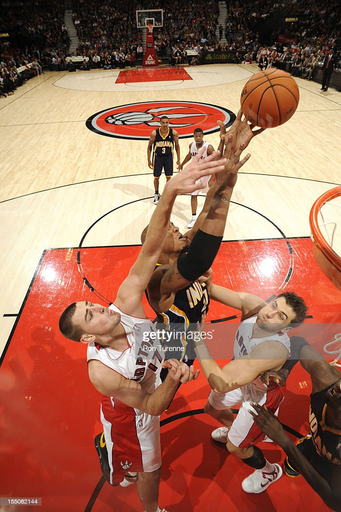 Jonas Valanciunas #17 of the Toronto Raptors attempts to block a shot against the Indiana Pacers on October 31, 2012 at the Air Canada Centre in Toronto, Ontario, Canada.