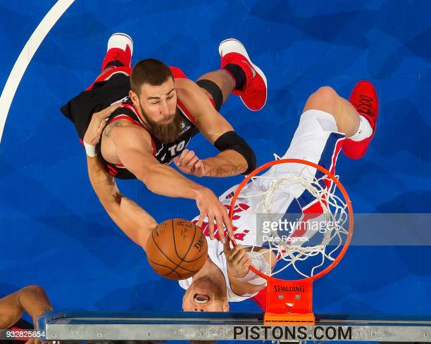 Jonas Valanciunas of the Toronto Raptors battles for the rebound with Blake Griffin of the Detroit Pistons in the second half of an NBA game at...