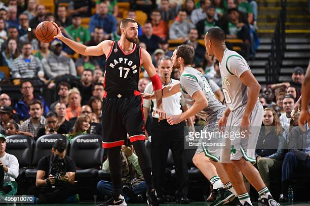 Jonas Valanciunas of the Toronto Raptors defends the ball against the Boston Celtics during the game on October 30 2015 at TD Garden in Boston...