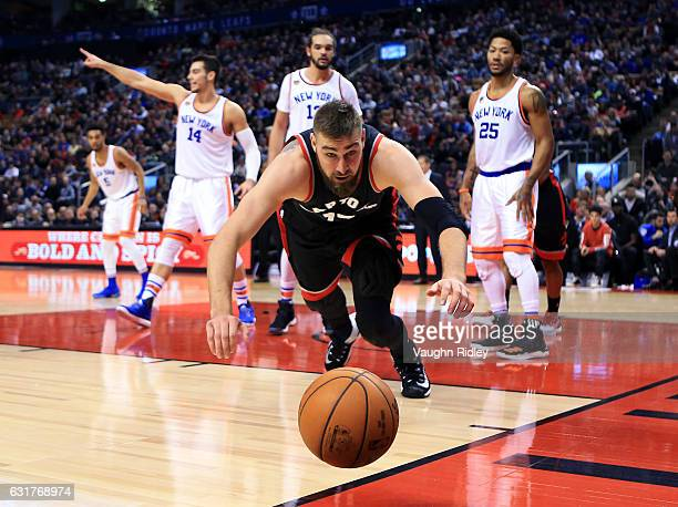 Jonas Valanciunas of the Toronto Raptors dives for the ball during the second half of an NBA game against the New York Knicks at Air Canada Centre on...