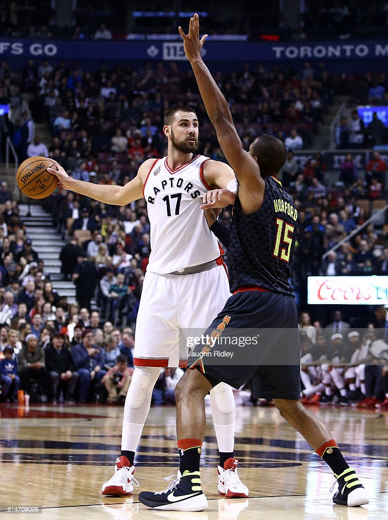 Jonas Valanciunas #17 of the Toronto Raptors dribbles the ball as Al Horford #15 of the Atlanta Hawks defends during the first half of an NBA game at the Air Canada Centre on March 10, 2016 in Toronto, Ontario, Canada.