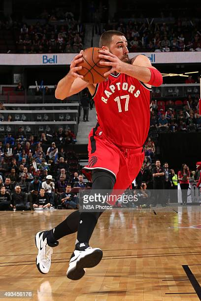 Jonas Valanciunas of the Toronto Raptors drives to the basket against the Minnesota Timberwolves during a preseaon game at Canadian Tire Centre on...