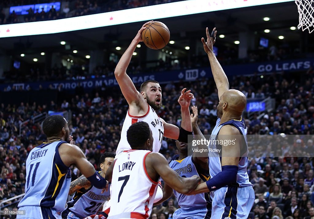 Jonas Valanciunas #17 of the Toronto Raptors drives to the basket as Vince Carter #15 of the Memphis Grizzlies defends during the second half of an NBA game at the Air Canada Centre on February 21, 2016 in Toronto, Ontario, Canada.