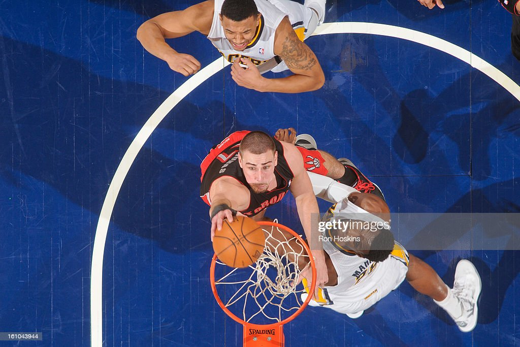 Jonas Valanciunas #17 of the Toronto Raptors dunks against Ian Mahinmi #28 of the Indiana Pacers on February 8, 2013 at Bankers Life Fieldhouse in Indianapolis, Indiana.