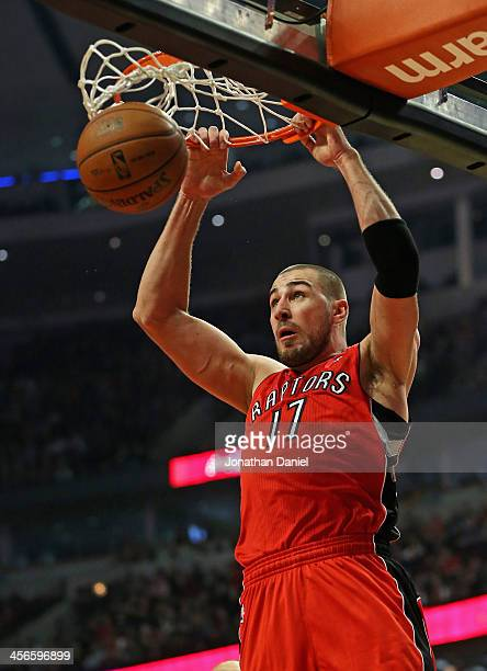 Jonas Valanciunas of the Toronto Raptors dunks against the Chicago Bulls at the United Center on December 14 2013 in Chicago Illinois NOTE TO USER...