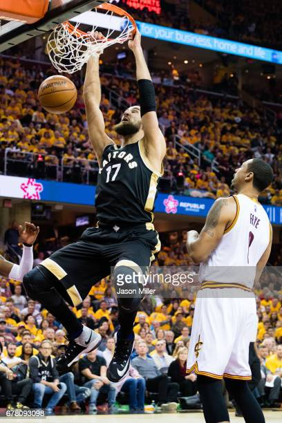 Jonas Valanciunas of the Toronto Raptors dunks over Channing Frye of the Cleveland Cavaliers during the first half of Game Two of the NBA Eastern...