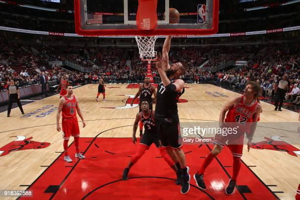 Jonas Valanciunas of the Toronto Raptors dunks the ball against the Chicago Bulls on February 14 2018 at the United Center in Chicago Illinois NOTE...