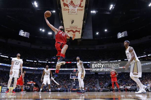 Jonas Valanciunas of the Toronto Raptors dunks the ball during the second half of a game against the New Orleans Pelicans at the Smoothie King Center...