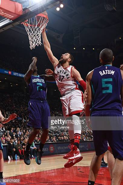 Jonas Valanciunas of the Toronto Raptors goes for the layup against the Charlotte Hornets during the game on January 1 2016 at Air Canada Centre in...