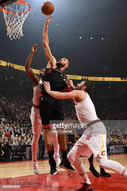 Jonas Valanciunas of the Toronto Raptors goes to the basket against the Cleveland Cavaliers on January 11 2018 at the Air Canada Centre in Toronto...