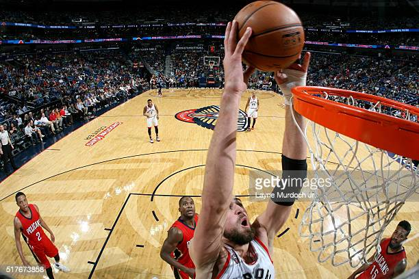 Jonas Valanciunas of the Toronto Raptors goes up for a dunk against the New Orleans Pelicans on March 26 2016 at Smoothie King Center in New Orleans...