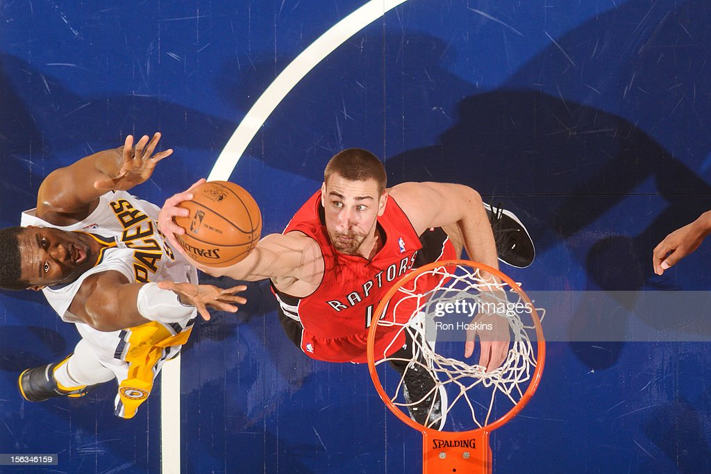 Jonas Valanciunas #17 of the Toronto Raptors grabs a rebound against Roy Hibbert #55 of the Indiana Pacers on November 13, 2012 at Bankers Life Fieldhouse in Indianapolis, Indiana.