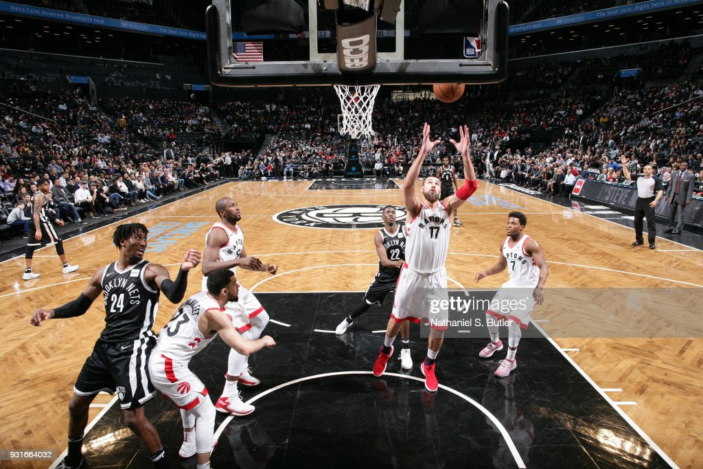 Jonas Valanciunas #17 of the Toronto Raptors grabs the rebound against the Brooklyn Nets on March 13, 2018 at Barclays Center in Brooklyn, New York.