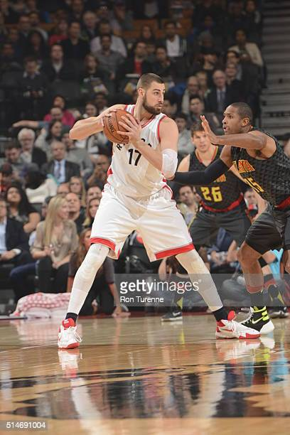 Jonas Valanciunas of the Toronto Raptors handles the ball against the Atlanta Hawks on March 10 2016 at the Air Canada Centre in Toronto Ontario...