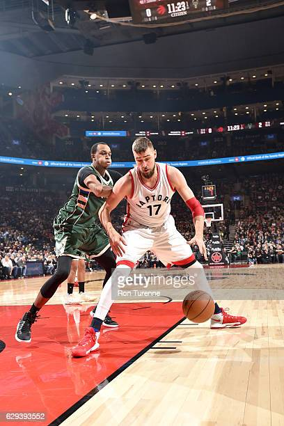 Jonas Valanciunas of the Toronto Raptors handles the ball against the Milwaukee Bucks on December 12 2016 at the Air Canada Centre in Toronto Ontario...